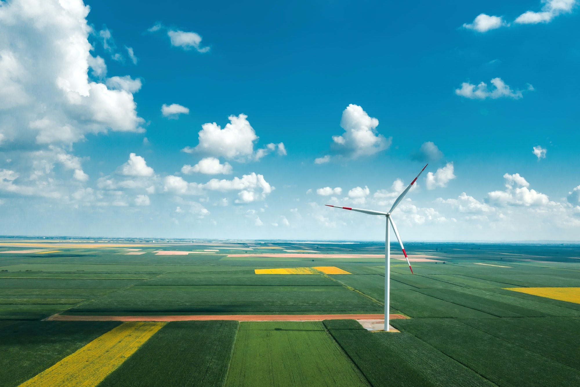Aerial view of wind turbines on modern wind farm from drone pov